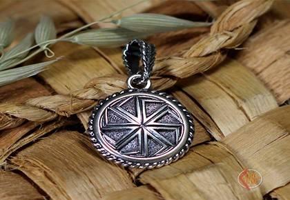Значение славянского символа черное солнце: кому подходит и как носить оберег