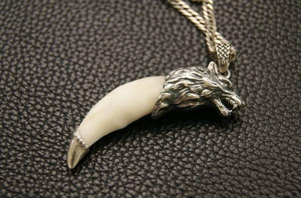 Значение оберега волчий клык и коготь волка, магические свойства талисмана и правила использования